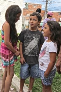 Kids watching the Seniors' Cumbia Demonstration