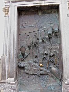 Brass door with relief
